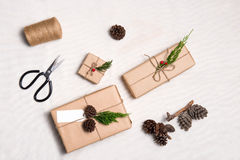 Christmas presents. Packages wrapped in kraft paper tied with. Jute and  label to copy space Royalty Free Stock Images
