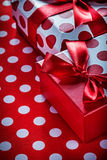 Christmas presents on polka-dot red textile celebrations concept Royalty Free Stock Image