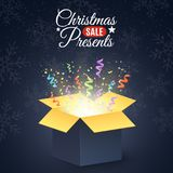 Christmas presents. Poster for the christmas sale. Open dark gift box. Confetti and colorful multicolored ribbons. Christmas prese Royalty Free Stock Photo