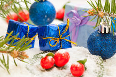 Christmas presents with red berries Stock Photography