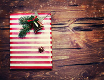 Christmas presents with red paper on dark wooden background in v Royalty Free Stock Photos