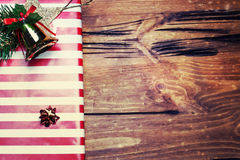 Christmas presents with red ribbon on dark wooden background i Royalty Free Stock Photos