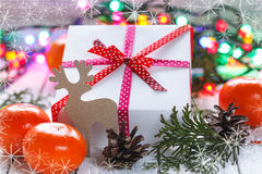 Christmas presents with red ribbon and tangerines Stock Photography