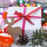 Christmas presents with red ribbon and tangerines Royalty Free Stock Photography