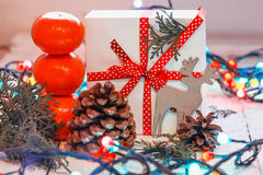 Christmas presents with red ribbon and tangerines Stock Images