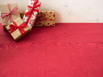 Christmas presents on red tablecloth Stock Image