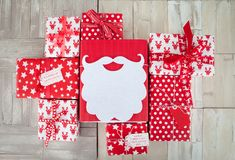 Presents in red and white wrapping paper Stock Images