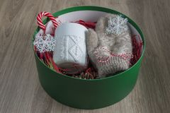 Christmas presents in a round green box. The concept of gifts stock photography