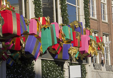 Christmas Presents. Row of Christmas presents as decoration on a department store during Christmas in Amsterdam royalty free stock image