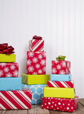 Christmas presents on rustic wood plank Royalty Free Stock Images