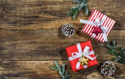 Christmas presents. On rustic wooden table background with natural ornaments Stock Image