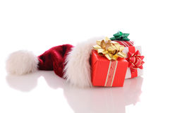 Christmas Presents in Santa Hat Stock Photography