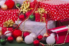 Christmas Presents. A selection of wrapped Christmas gifts and decorations, some of the gifts are hand crafted Stock Photo