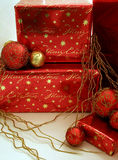 Christmas Presents Series 1 - Boxes and Ornaments. Red and gold wrapped presents with Christmas ornaments stock image