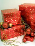 Christmas Presents Series 1 - Boxes and Ornaments7. Red and gold wrapped presents with Christmas ornaments stock photography