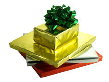 Christmas presents in shiny foil wrappers Stock Photography