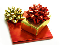 Christmas presents in shiny foil wrappers Royalty Free Stock Photography