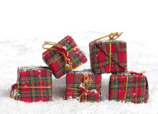 Christmas presents in the snow Stock Photo