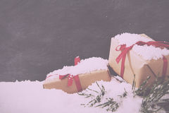 Christmas presents in snow against a blackboard Vintage Retro Fi Stock Photography