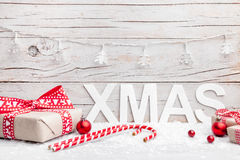 Christmas presents with snow on wooden background Royalty Free Stock Photo