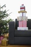 Christmas Presents On Sofa Stock Photos