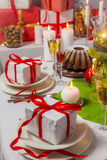 Christmas presents for someone special on the table. In home Stock Image