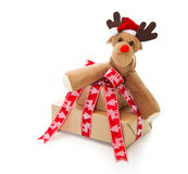 Christmas presents with stuffed reindeer isolated Royalty Free Stock Photos