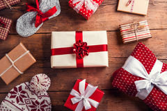 Christmas presents on a table. Christmas presents laid on a wooden table background Stock Photos