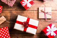 Christmas presents on a table. Christmas presents laid on a wooden table background Stock Photo
