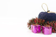 Christmas presents and tinsel. Isolated on white background with copy space Royalty Free Stock Images
