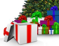 Christmas presents by tree. Over white Royalty Free Stock Images