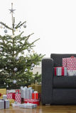 Christmas Presents By Tree And Sofa Royalty Free Stock Images
