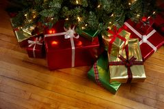 Christmas Presents under a Christmas tree Royalty Free Stock Image