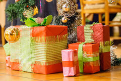 Christmas presents under a Christmas tree. In home stock photo