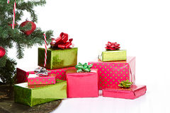Christmas presents under a Christmas tree. With an isolated white background stock photo