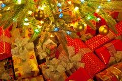 Christmas presents under tree Stock Photo