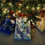 Christmas presents under tree. Christmas presents under decorated Christmas tree stock photography