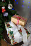 Christmas presents under a tree with defocused lights. Christmas presents under a Christmas tree with defocused lights stock photo
