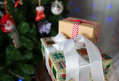 Christmas presents under a tree with defocused lights. Christmas presents under a Christmas tree with defocused lights royalty free stock images