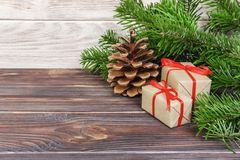 Christmas presents under a tree. Fir branches. Xmas and Happy New Year composition.  stock photo