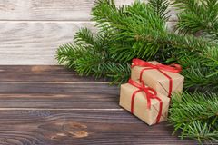 Christmas presents under a tree. Fir branches. Xmas and Happy New Year composition.  stock photos