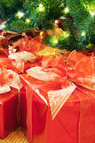 Christmas presents under the tree. Christmas presents under an illuminated tree. Selective focus on presents stock image