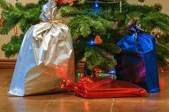 Christmas presents under the tree. Red, blue, silver christmas presents under the tree royalty free stock photography
