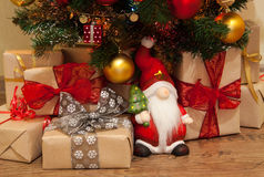 Christmas presents under the tree. Santa with Christmas presents under the tree royalty free stock photography