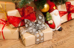 Christmas presents under the tree. Santa with Christmas presents under the tree royalty free stock images