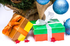 Christmas presents under the tree. On a white background stock photography