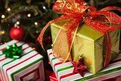 Christmas presents under a tree Stock Photo