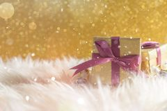 Christmas presents in warm white blanket. Christmas celebration holiday background. New year and christmas celebration concept Stock Photography