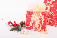 Christmas presents on white snow close-up Royalty Free Stock Photo