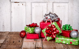 Christmas Presents on Wooden Background Stock Photos
